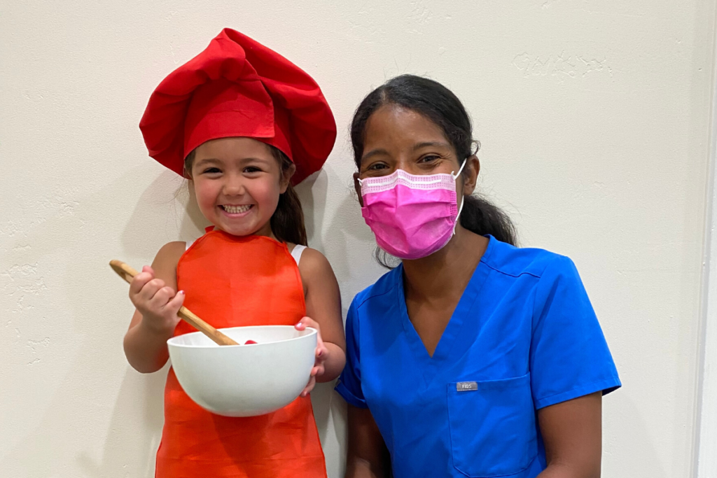 dr-veronica-baking-with-young-child-at-scottsdale-pediatric-dental-clinic