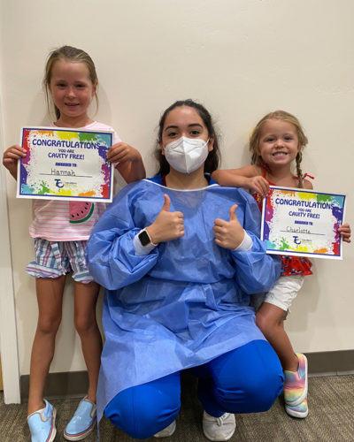 cavity-free-hannah-charlotte-with-pediatric-dentist-team-member